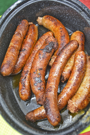 Traditionally prepared sausages in a pot are waiting for sale.