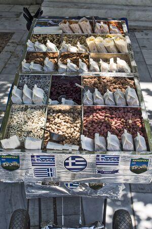 Photo pour ATHENS, GREECE, JUN 04, 2016 Street mobile sales of fine fresh oriental snacks. - image libre de droit