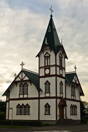 Wooden church built in 1907 in Husavik small town and harbor in north Iceland