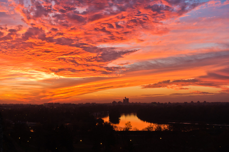 Dramatic colorful sunset over confluence of Danube and Sava river in Belgrade, Serbia
