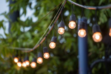 Foto de Hanging decorative christmas lights for a wedding ceremony - Imagen libre de derechos
