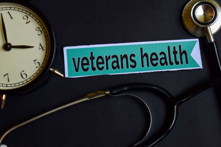 Veterans Health on the print paper with Healthcare Concept Inspiration. alarm clock, Black stethoscope.