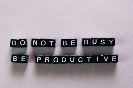 Foto de Don't be busy, be productive on wooden blocks. Motivation and inspiration concept - Imagen libre de derechos