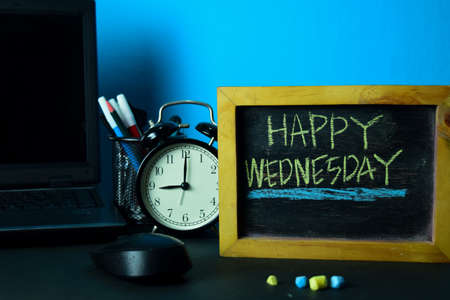 Photo for Happy Wednesday Planning on Background of Working Table with Office Supplies. Business Concept Planning on Blue Background - Royalty Free Image