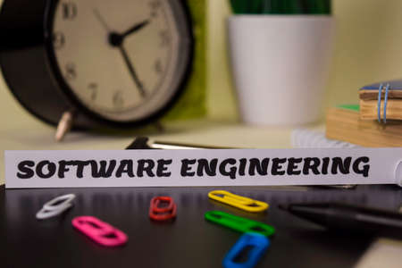 Software Engineering on the paper isolated on it desk. Business and inspiration concept