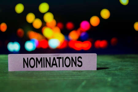 Nominations on the sticky notes with bokeh background