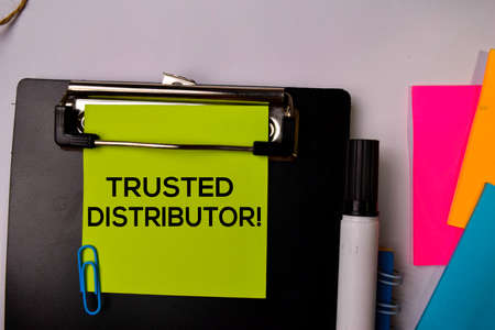 Trusted Distributor on sticky notes isolated on white background.