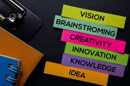 Photo for Vision, Brainstroming, Creativity, Innovation, Knowledge, Idea text on sticky notes isolated on Black desk. Mechanism Strategy Concept - Royalty Free Image
