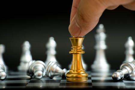 Photo pour Businessman hold gold king with silver pawn lay down in chess game on black background (Concept for vitory in business, leadership) - image libre de droit