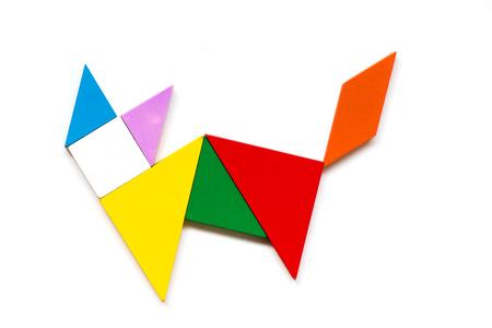 Foto de Color wood tangram puzzle in cat shape on white background - Imagen libre de derechos