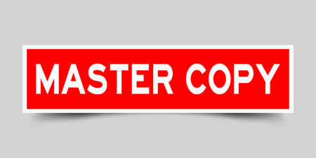 Square red sticker label in word master copy on gray background