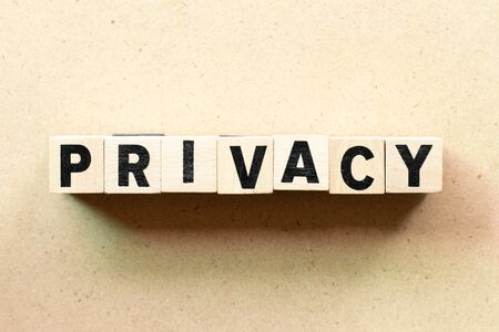 Foto de Letter block in word privacy on wood background - Imagen libre de derechos