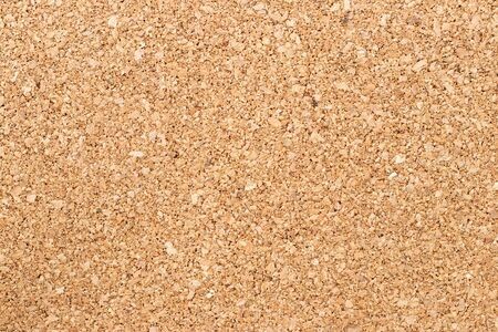 Foto de Brown yellow color of cork board textured background - Imagen libre de derechos