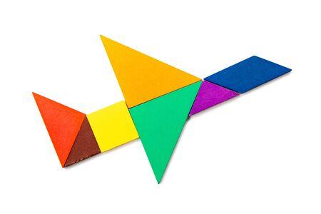 Photo pour Color wood tangram puzzle in airplane shape on white background - image libre de droit