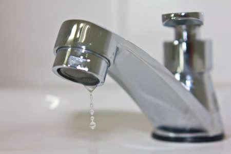 Modern faucet closeup with water drop