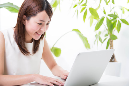 Photo for Young woman with laptop - Royalty Free Image
