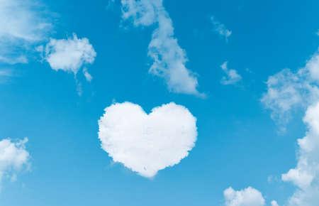 Photo pour Heart shaped clouds on blue sky background. - image libre de droit