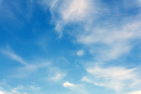 Abstract artistic background with blue sky and white translucent smoky clouds