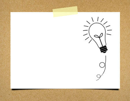 ฺBulb idea note paper on board background