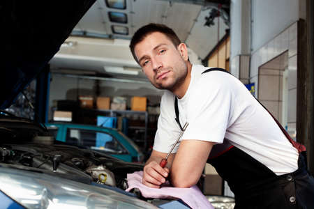handsome car mechanic in auto repair shop