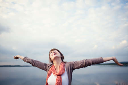 Photo for Happy young woman with arms raised, outdor. - Royalty Free Image