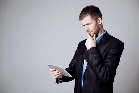 Businessman using digital tablet isolated