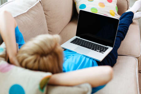 Woman relaxing with laptop on couch