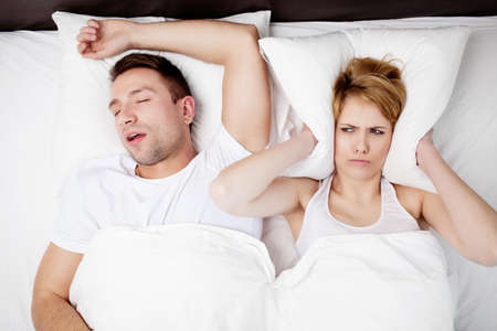 Photo pour Snoring man and young woman. Couple sleeping in bed. - image libre de droit