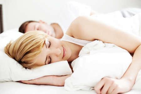 Photo pour Portrait of couple sleeping in the bed - image libre de droit