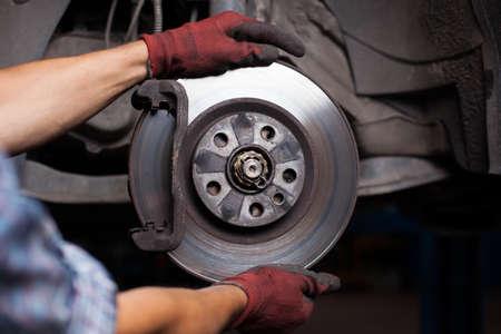 Photo pour Repairing brakes on car - image libre de droit