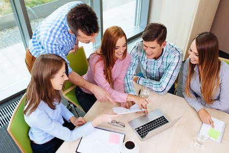 Photo pour Corporate Training. Teacher working with gorup of people. - image libre de droit