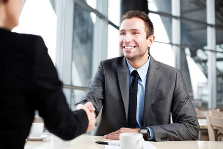 Photo for Happy businessman shaking hand with businesswoman. - Royalty Free Image