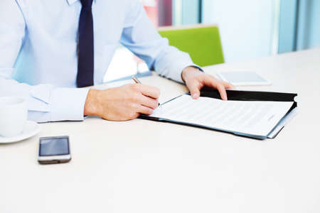 Photo pour Signing contract. Business concept. Closeup of businessman working in the office. - image libre de droit