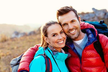 Photo pour Portrait of a happy couple of hikers - image libre de droit