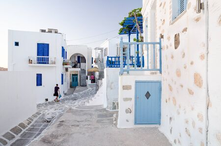 Photo for A typical street with white houses in Paros or Parikia, Cyclades islands, Greece - Royalty Free Image