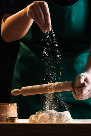 Foto per Hands of a chef baker woman kneading dough - Immagine Royalty Free