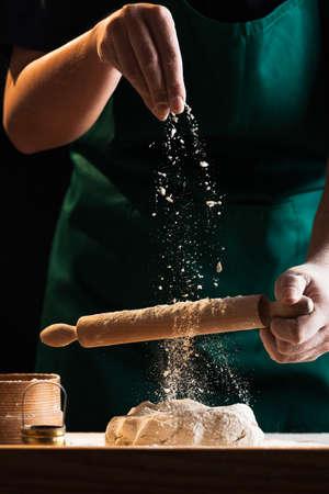 Foto de Hands of a chef baker woman kneading dough - Imagen libre de derechos