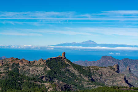 Gran Canaria island mountains and valleys landscape, view from highest peak Pico de las Nieves to Roque Nublo and Mount Teide on Tenerife