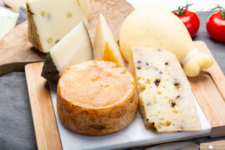 Photo pour Cheese collection, Variety of Italian pecorino and provolone cheeses, aged with black peppers from Nebrodi, white Il Palio and black molarotto, close up - image libre de droit