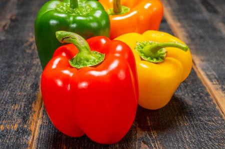 Foto für Fresh red, orange, green and yellow sweet bell paprika close up - Lizenzfreies Bild