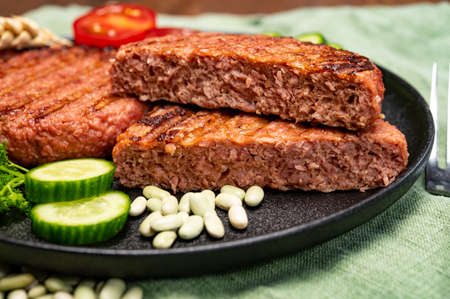 Photo for Source of fiber plant based vegan soya protein grilled burgers, meat free healthy food close up - Royalty Free Image