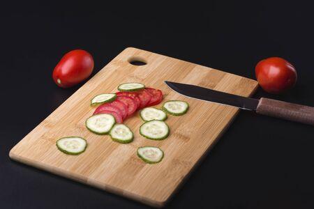 Salad. Cooking vegetable salad. Salad of tomatoes and cucumbers. Tomatoes and cucumbers.