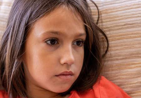 Photo pour Portrait of little girl with sad look - image libre de droit