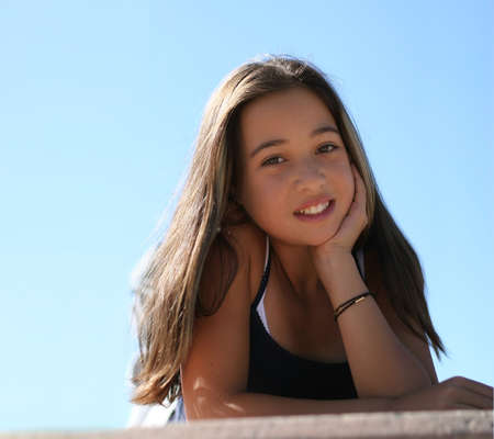 Photo for Asian teen girl against the sky - Royalty Free Image