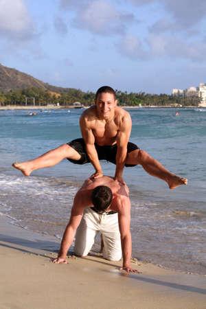 Two teenage boys having fun on the beach