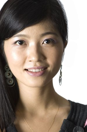 Smiling Chinese girl - portrait. Young, pretty Asian model with kind face expression and charming eyes.