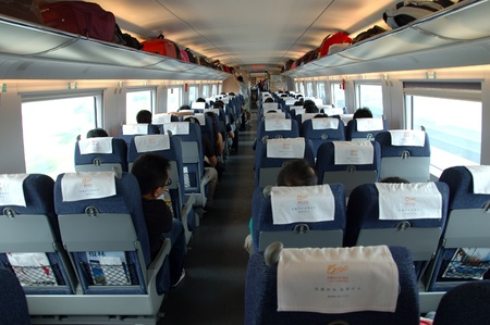 GUANGZHOU, CHINA - SEPTEMBER 29: China invests in fast and modern railway, trains with speed over 340 km/h. Passengers inside the train on the way from Guangzhou to Wuhan on September 29, 2010.