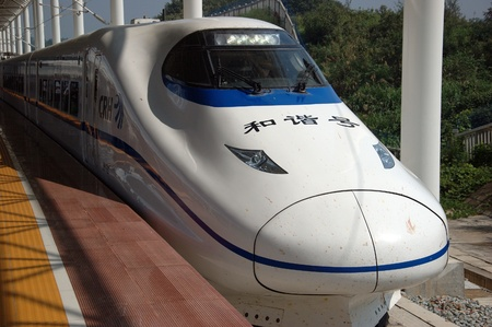 YUEYANG - HUNAN, CHINA - OCTOBER 3: China invests in fast and modern railway, trains with speed over 340 km/h. Modern train approaches station on October 3, 2010 in YueYang station.