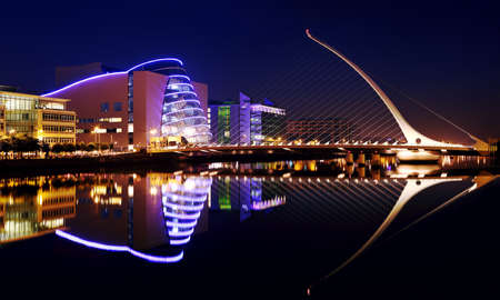 DUBLIN, IRELAND - JULY 22  Barrel shaped Dublin Convention Center  The CCD  and Samuel Beckett Bridge by architect Santiago Calatrava reflecting in the river Liffey on July 22, 2013 in Dublin, Ireland