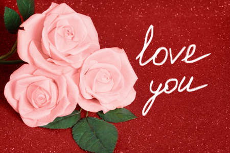 Photo for Valentines day card with three pink Roses on red boke Background. Love and Wedding Day concept. Card valentine day roses text. - Royalty Free Image